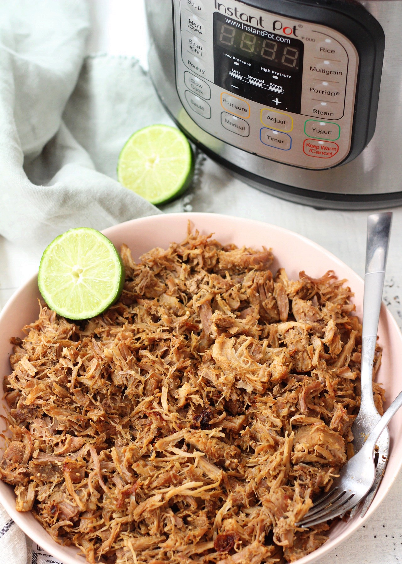 Easy Whole30 and Paleo instant pot pork carnitas only take a few simple ingredients and less than an hours time to cook perfectly! This is a great whole30 pork recipe for meal prep, or as a family friendly recipes for tacos or burritos! #paleocarnitas #whole30instantpot #whole30carnitas