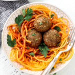 This easy meatball recipe is tried and true and the best way to make meatballs! Made paleo and Whole30 but still every bit as juicy and delicious. Served over butternut squash noodles and marinara here, the ways you can enjoy this low carb meatball recipe is endless!