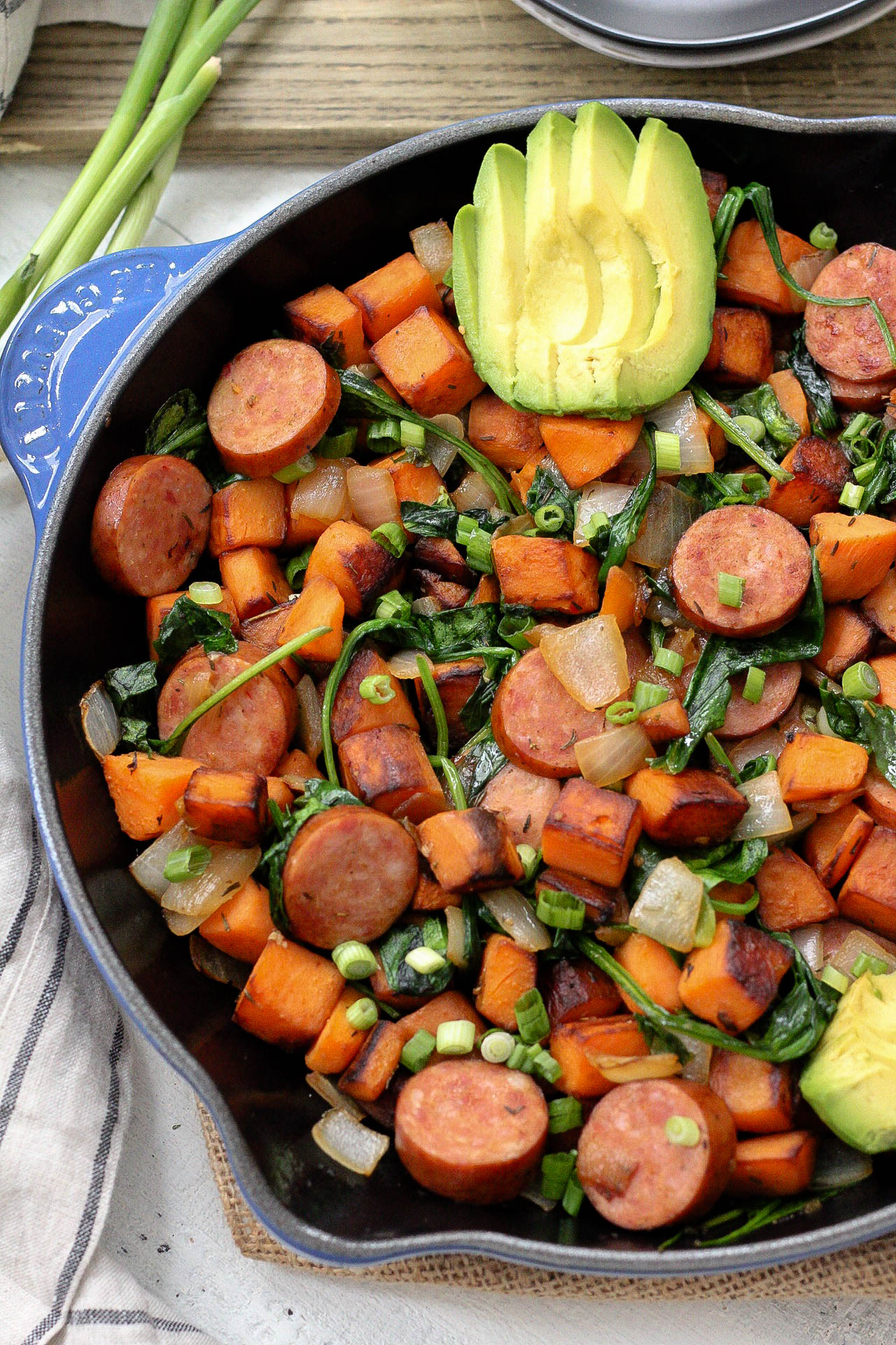 An easy Paleo egg-free breakfast recipe is always a simple go to meal. This skillet is full of healthy vegetables, flavorful spices and sausage! This egg-free breakfast is also Whole30 for when you're sick of eggs or want to meal prep breakfast! #eggfreebreakfast #paleobreakfast #whole30breakfast #breakfastskillet #breakfasthash